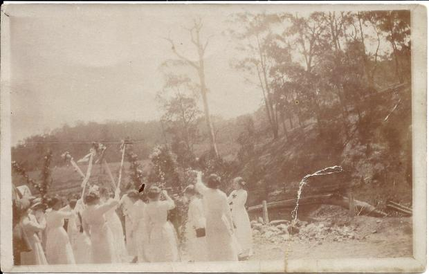 Guard of honour by girls, dressed in white, at the opening of the Mission Hall.